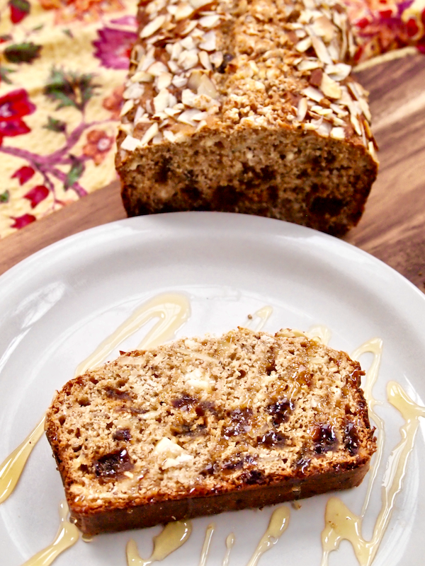 Vanilla Almond Bread with Dates and Goat Cheese | Sweet fruits and aromatic vanilla lend their flavors to this incredible  bread! Savory goat cheese adds delicious creaminess, sliced almonds add the perfect amount of crunch, and candy-like dates are spread throughout every slice. Whole-grain and naturally sweetened this unique loaf only TASTES rich and indulgent!
