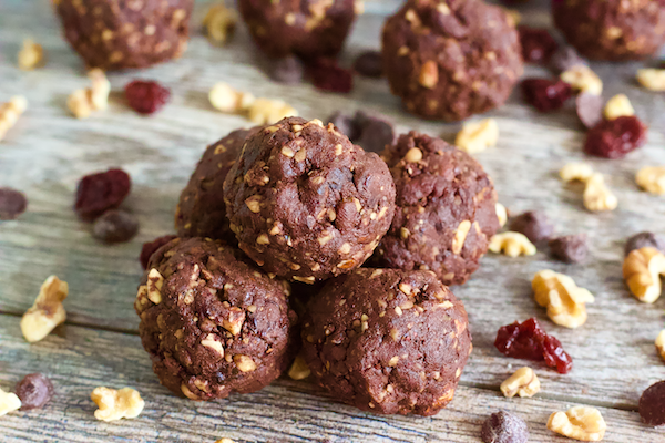 Chocolate Cherry Mocha Brownie Bites | Rich cocoa and sweet cherries combine in these raw, vegan brownie bites! Amazing chocolate flavor is complimented with a hint of coffee and lots of crunch from raw almonds and walnuts. These bites taste decadent, but are actually healthy and full of plant-based protein. The ultimate no-bake brownie treat!