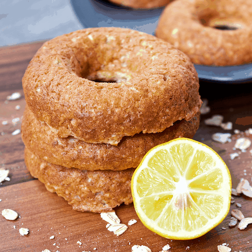Lemon Meringue Donuts | Luscious lemon donuts that are deliciously sweet and ever so subtly tart! Fresh, fruity, and full of protein, these easy to make, gluten-free donuts make the perfect summer snack.