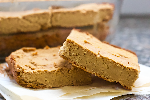 3-Ingredient Peanut Butter Blondies | It only takes 3 simple, every day ingredients to create these lusciously fudgy peanut butter blondies! Dense and delicious, biting into one of these bars will transport you to peanut butter heaven. Vegan, grain-free, and easy to make!