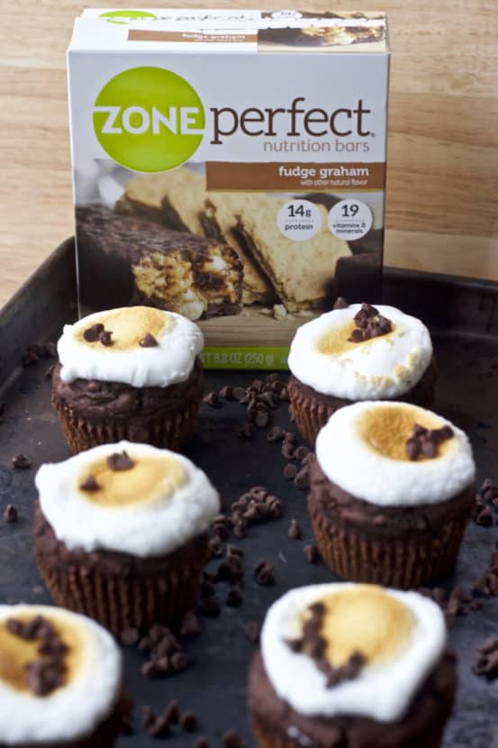 Fudge Ripple S'mores Muffins | Healthy Helper @Healthy_Helper All the flavor of your favorite childhood treat bundled into a light n' fluffy, fudge-filled muffin! Topped with a perfectly golden marshmallow and stuffed with graham cracker pieces, these gluten-free muffins make the perfect healthy snack or sweet treat for the family!
