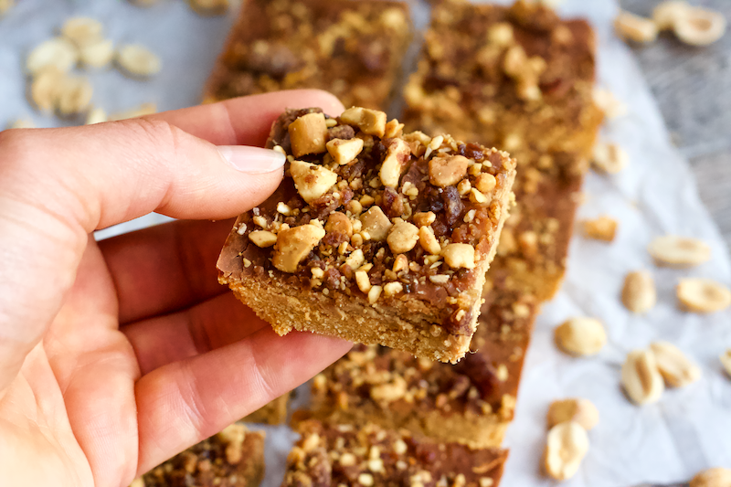 Peanut Butter and Jelly Protein Fudge Bars | Soft, dense, peanut buttery fudge filled with the subtle sweetness of strawberry flavor. The classic combination of peanut butter and jelly comes together in these deliciously healthy protein fudge bars! Vegan, gluten-free, grain-free, and only 5 ingredients.