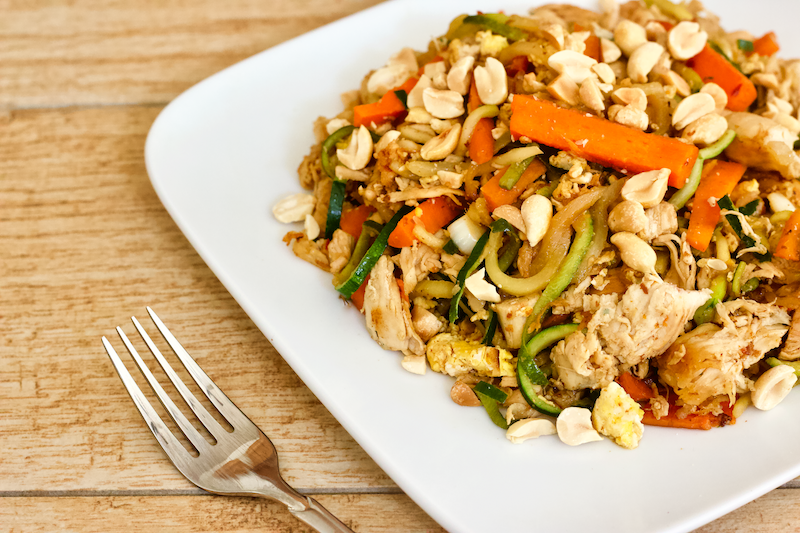 Healthy Low-Carb Chicken Pad Thai | A healthy low-carb alternative to your favorite takeout meal! Full of veggies, flavorful sauce, and lean proteins, this delicious Chicken Pad Thai recipe will be your new go-to for when you're craving Thai food.