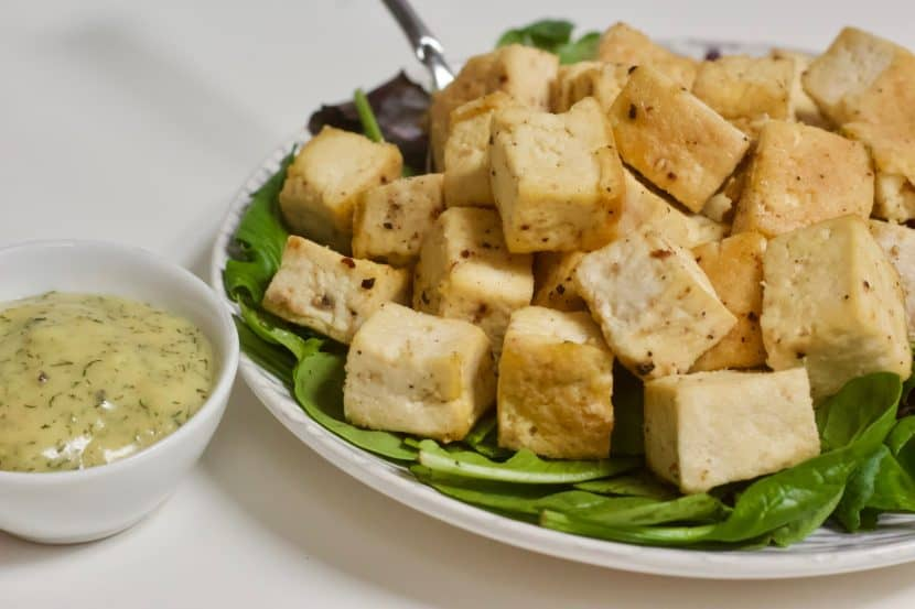 Baked Tofu with White Wine, Dill, & Mustard Sauce | Healthy Helper Perfectly baked tofu pairs creamy, tangy sauce for a delicious plant-based main dish! A great addition to a holiday menu or to make for an easy meatless weeknight meal. Vegan, gluten-free, low in fat and carbs, and SO flavorful. This will be your new favorite way to prepare tofu!