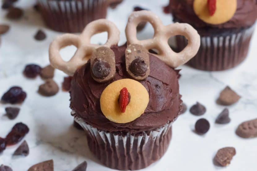 Rudolph the Red Nosed Reindeer Cupcakes | Healthy Helper Delicious chocolate cupcakes decorated to the likeness of Rudolph, the Red Nosed Reindeer! The ULTIMATE holiday treat to make for your friends and family. Vegan, gluten-free, and naturally sweetened.
