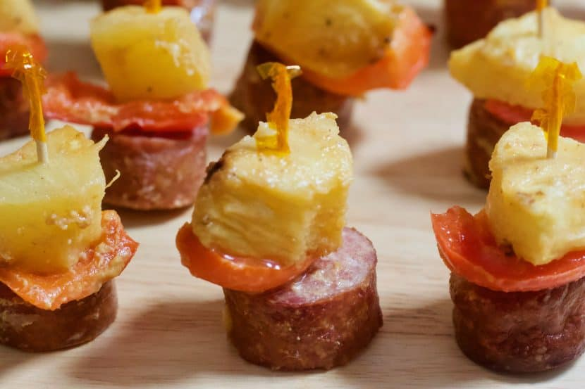 Sausage, Pepper, and Pineapple Skewers | Perfectly portioned, sweet and savory sausage kabobs paired with fresh red peppers and pineapple. Baked with a tangy Dijon-maple sauce, these mini-kabobs are a meaty mouthful that everyone will love to munch at your next get-together.