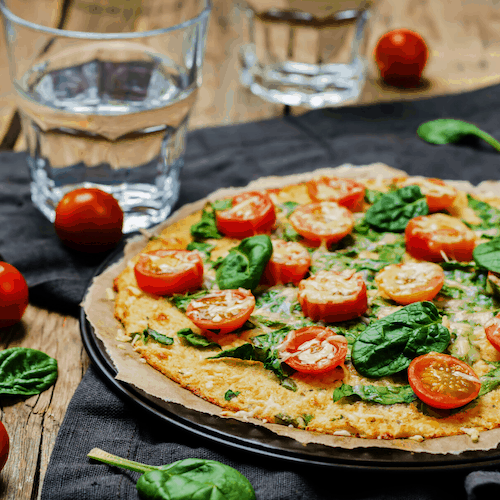 No-Fail Cauliflower Crust Pizza | The only cauliflower crust recipe you'll ever need! High protein, gluten-free, grain-free, and only TWO ingredients. This truly is the no-fail pizza crust recipe that anyone can make!