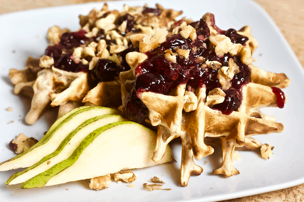 Cinnamon Pear Waffles with Homemade Blueberry Syrup | Cinnamon pear waffles with homemade blueberry syrup and walnuts. This sweet waffle recipe will surely become your new favorite breakfast!