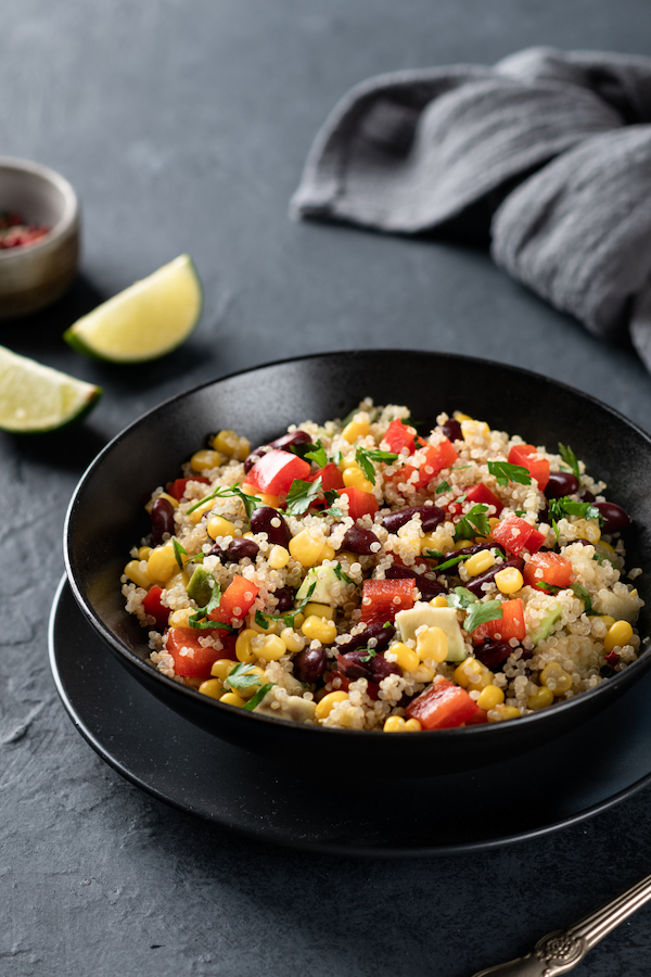Quinoa Black Bean Veggie Salad with Mango and Avocado | A veggie packed salad filled with fiber and plant-based protein from quinoa and black beans. Vegan, gluten-free, and oil-free.