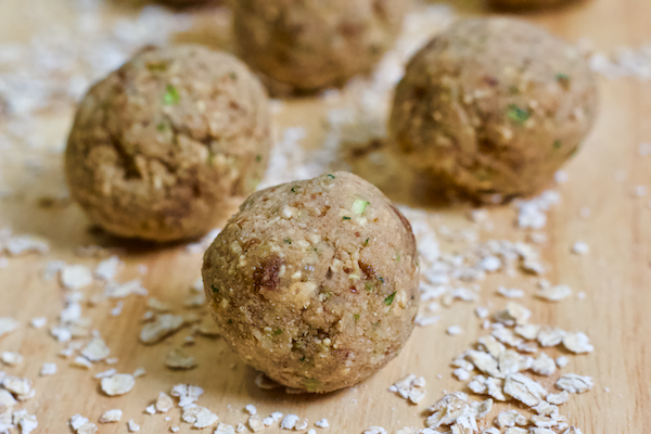 No Bake Zucchini Bread Bites | High carb, low-fat vegan Zucchini Bread Bites are perfect for snacking on while sneaking in some extra veggies! Gluten-free and only sweetened with fruit, these bites are great for kids and adults alike. All the taste of zucchini bread with no need to turn the oven on!